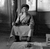 Chinese Man with Pipe